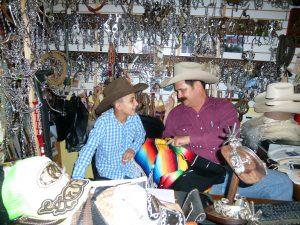 Juan Jorge teaching his son a few leather secrets !